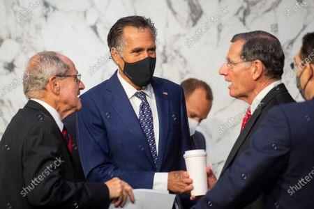 United States Senator Jim Risch (Republican of Idaho), left, chats with United States Senator Mitt Romney (Republican of Utah), center, and United States Senator John Barrasso (Republican of Wyoming) during a Senate Committee on Foreign Relations business meeting for nominations and legislative considerations in the Hart Senate Office Building in Washington, DC,.
