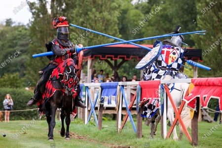 Mediaeval jousting returned to Hever Castle and Gardens in Kent this weekend with events taking place on both Saturday and Sunday.Actors that make up 'The Knights of Royal England' are pictured entertaining the crowds with exhilarating displays of action, stunts, falls and fights in an authentic arena complete with a Royal Box. About Hever CastleDating back to the 13th century, Hever Castle was once the childhood home of Anne Boleyn, second wife of Henry VIII and Mother of Elizabeth I. It formed the unlikely backdrop to a sequence of tumultuous events that changed the course of Britain's history, monarchy and religion. The castle is also set within 125 acres of glorious grounds.