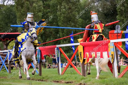 Stock Image of Mediaeval jousting returned to Hever Castle and Gardens in Kent this weekend with events taking place on both Saturday and Sunday.Actors that make up 'The Knights of Royal England' are pictured entertaining the crowds with exhilarating displays of action, stunts, falls and fights in an authentic arena complete with a Royal Box. About Hever CastleDating back to the 13th century, Hever Castle was once the childhood home of Anne Boleyn, second wife of Henry VIII and Mother of Elizabeth I. It formed the unlikely backdrop to a sequence of tumultuous events that changed the course of Britain's history, monarchy and religion. The castle is also set within 125 acres of glorious grounds.