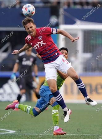 Dallas defender Bressan heads the ball in front of Seattle Sounders forward Raul Ruidiaz during the first half of an MLS soccer match, in Seattle
