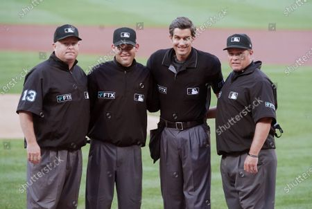 Major League Umpires (L to R) Todd Tichenor, Dan Merzel, John Tumpane and Marvin Hudson pose for a photograph before the start of the Atlanta Braves-St. Louis Cardinals baseball game at Busch Stadium in St. Louis on Wednesday, August 4, 2021.