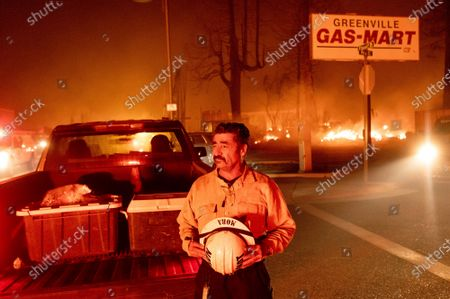 Stock Picture of Battalion Chief Sergio Mora watches as the Dixie Fire tears through the Greenville community of Plumas County, Calif., on . The fire leveled multiple historic buildings and dozens of homes in central Greenville