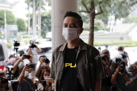 Hong Kong singer and pro-democracy activist Anthony Wong arrives at a court . Wong and a pro-democracy activist who were charged with corrupt conduct for providing entertainment to voters to sway their votes in a by-election, had their charges dropped on Thursday