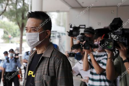 Hong Kong singer and pro-democracy activist Anthony Wong arrives at a court . Wong, who was charged with corrupt conduct for allegedly providing entertainment to voters to sway their votes in a by-election, had the charges dropped on Thursday