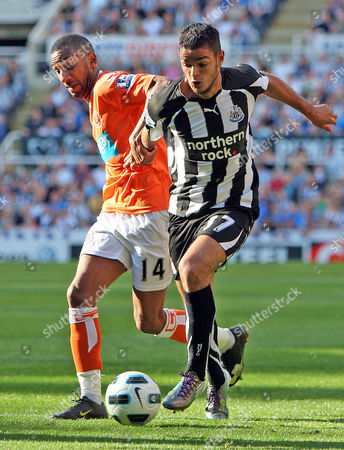 Elliot Grandin of Blackpool and Hatem Ben Arfa of Newcastle United
