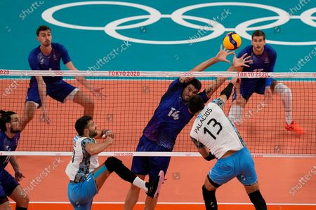 Stock Image of France's Nicolas le Goff tries to block a hit bay Argentina's Ezequiel Palacios, during a men's volleyball semifinal match, at the 2020 Summer Olympics, in Tokyo, Japan