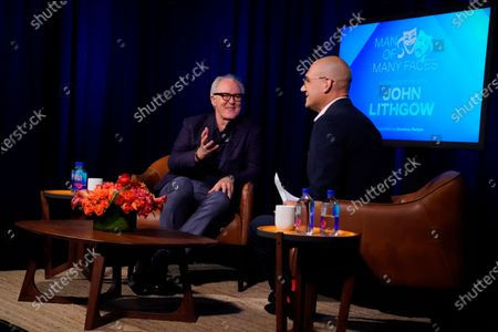 Stock Picture of John Lithgow and Dominic Patten speak, in Burbank, Calif