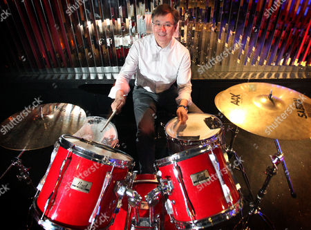 Stock Photo of Irwin Lee playing the drums