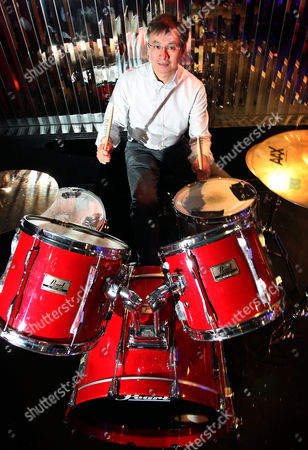 Stock Image of Irwin Lee playing the drums