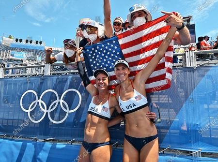 Gold medalist USA's April Ross and Alix Klineman celebrate after the Final against Australia during Tokyo Olympics Women's Beach Volleyball at Shiokaze Park in Tokyo, Japan on Friday, August 6, 2021.