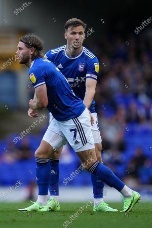 Lee Evans of Ipswich Town (8) helps up Wes Burns of Ipswich Town (7)