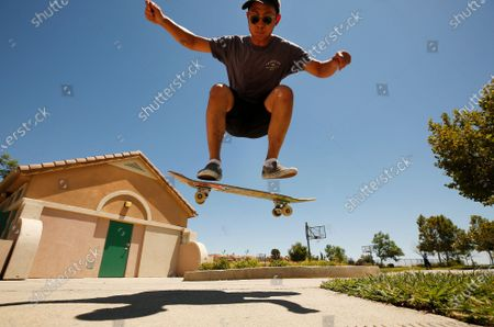 """Brian Park, 27, on break from classes at CSUN practices a Kickflip on his skateboard at Porter Ranch Park Monday afternoon as heat advisories came into effect for the San Fernando and Santa Clarita Valleys. """"I've been skating since I was a little kid but since Covid I'm picking it up again. But it's getting too hot today,"""" Brian exclaimed. The heat advisory began at 10 am today and runs through midweek with the National Weather Service warning that critical fire conditions are expected, including triple-digit temperatures in some areas, low humidity and gusty winds. Porter Ranch Park on Monday, Aug. 2, 2021 in Porter Ranch, CA. (Al Seib / Los Angeles Times)."""
