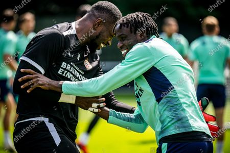 Goalkeeper Yvon Mvogo and Noni Madueke of PSV during the last training session at The Herdgang training complex prior to the match for the Johan Cruijff Scale. In the Johan Cruijff Arena, the people of Eindhoven will compete against the current national champion Ajax.