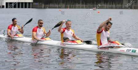 Marcus Walz, Rodrigo Germade, Carlos Arevalo and Saul Craviotto of Spain react after their silver medal finish in the men's kayak four 500m final at the 2020 Summer Olympics, in Tokyo, Japan