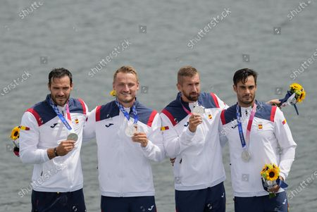 Stock Photo of Marcus Walz, Rodrigo Germade, Carlos Arevalo and Saul Craviotto of Spain hold up their silver medals after finishing second in the men's kayak four 500m final at the 2020 Summer Olympics, in Tokyo, Japan