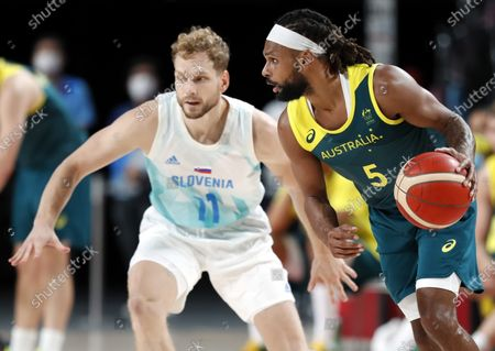 Australia's Patty Mills (R) in action against Slovenia's Jaka Blazic (L) during the Men's Basketball bronze medal match between Slovenia and Australia at the Tokyo 2020 Olympic Games at the Saitama Super Arena in Saitama, Japan, 07 August 2021.