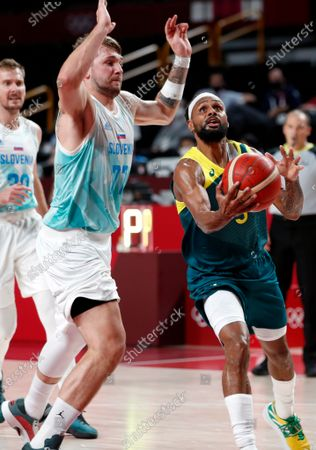 Australia's Patty Mills (R) in action against Slovenia's Luka Doncic (L) during the Men's Basketball bronze medal match between Slovenia and Australia at the Tokyo 2020 Olympic Games at the Saitama Super Arena in Saitama, Japan, 07 August 2021.
