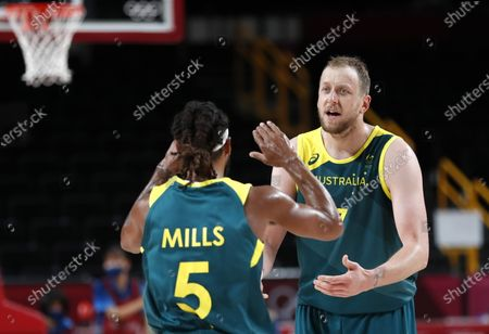 Australia's Patty Mills (L) celebrateswith teammate Joe Inges (R) during the Men's Basketball bronze medal match between Slovenia and Australia at the Tokyo 2020 Olympic Games at the Saitama Super Arena in Saitama, Japan, 07 August 2021.
