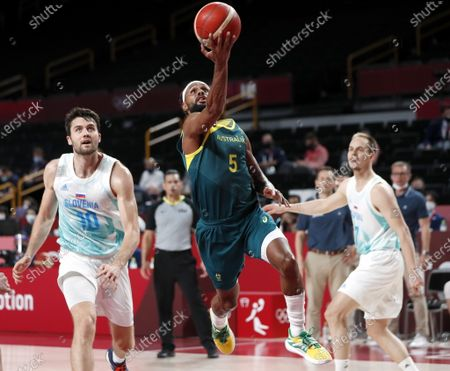 Australia's Patty Mills (C) in action during the Men's Basketball bronze medal match between Slovenia and Australia at the Tokyo 2020 Olympic Games at the Saitama Super Arena in Saitama, Japan, 07 August 2021.