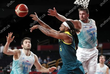 Australia's Patty Mills (C) in action against Slovenia's Luka Doncic (R) during the Men's Basketball bronze medal match between Slovenia and Australia at the Tokyo 2020 Olympic Games at the Saitama Super Arena in Saitama, Japan, 07 August 2021.