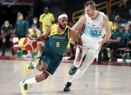 Australia's Patty Mills (C) in action against Slovenia's  Mike Tobey (R) during the Men's Basketball bronze medal match between Slovenia and Australia at the Tokyo 2020 Olympic Games at the Saitama Super Arena in Saitama, Japan, 07 August 2021.