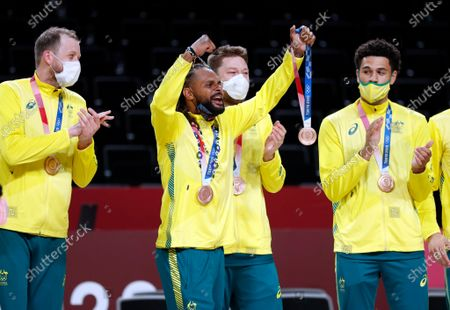 Bronze medalist Patty Mills (2-L) of Australia celebrates with teammates during the award ceremony after the Men's Basketball bronze medal match between Slovenia and Australia at the Tokyo 2020 Olympic Games at the Saitama Super Arena in Saitama, Japan, 07 August 2021.