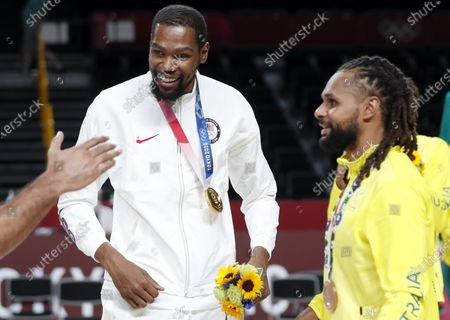 Gold medalist Kevin Durant (L) of USA and bronze medalist Patty Mills (R) of Australia celebrate on the podium during award ceremony after the Men's Basketball bronze medal match between Slovenia and Australia at the Tokyo 2020 Olympic Games at the Saitama Super Arena in Saitama, Japan, 07 August 2021.