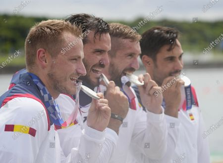 (L-R) Silver medalists Marcus Walz, Saul Craviotto, Carlos Arevalo and Rodrigo Germade of Spain bite their medals during the Men's Kayak Four 500m Finals awarding ceremony at the Tokyo 2020 Olympic Games at the Sea Forest Waterway in Tokyo, Japan, 07 August 2021.