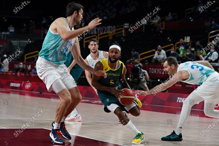 Australia point guard Patty Mills (5) drives to the basket during the Men's Basketball bronze medal game at the Tokyo Olympic Games in Tokyo, Japan, on Saturday, August 7, 2021.