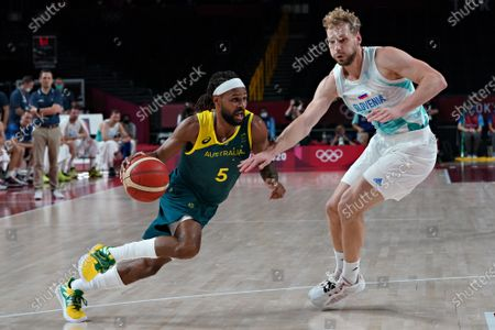 Australia point guard Patty Mills (5) slips past Slovenia shooting guard Jaka Blazic (11), as he drives to the basket during the Men's Basketball bronze medal game at the Tokyo Olympic Games in Tokyo, Japan, on Saturday, August 7, 2021.