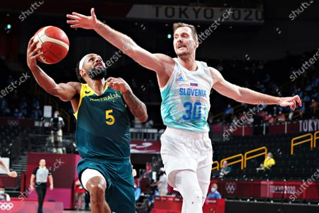 Australia point guard Patty Mills (5) slips past Slovenia guard Zoran Dragic (30), as he drives to the basket during the Men's Basketball bronze medal game at the Tokyo Olympic Games in Tokyo, Japan, on Saturday, August 7, 2021.
