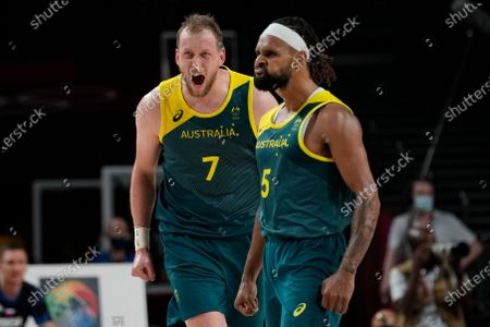 Australia's Joe Ingles (7) and Patty Mills (5) react to a score by Mills against Slovenia during the men's bronze medal basketball game at the 2020 Summer Olympics, in Tokyo, Japan