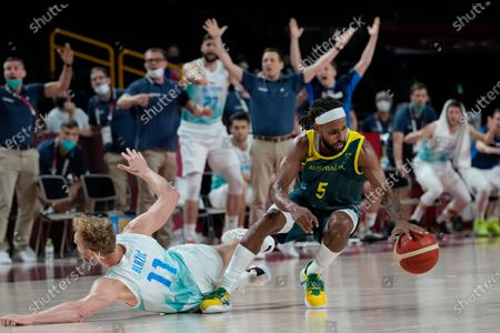 Australia's Patty Mills (5) and Slovenia's Jaka Blazic (11) scramble for a loose ball during the men's bronze medal basketball game at the 2020 Summer Olympics, in Tokyo, Japan