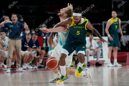 Australia's Patty Mills (5) gets tangled up with Slovenia's Jaka Blazic (11) during the men's bronze medal basketball game at the 2020 Summer Olympics, in Tokyo, Japan