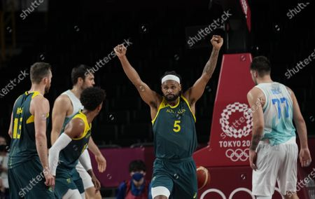 Stock Image of Australia's Patty Mills (5) reacts as time runs down against Slovenia during the men's bronze medal basketball game at the 2020 Summer Olympics, in Tokyo, Japan