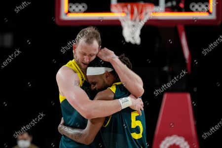 Stock Picture of Australia's Joe Ingles (7) and Patty Mills (5) react after beating Slovenia 107-93 during the men's bronze medal basketball game at the 2020 Summer Olympics, in Tokyo, Japan