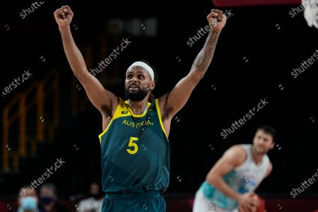 Stock Photo of Australia's Patty Mills (5) reacts as time runs down against Slovenia during the men's bronze medal basketball game at the 2020 Summer Olympics, in Tokyo, Japan