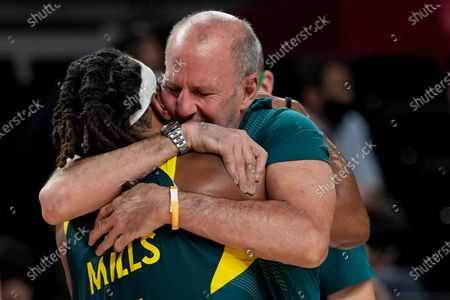 Australia head coach Brian Goorjian hugs Patty Mills (5) after Australia defeated Slovenia 107-93 in the men's bronze medal basketball game at the 2020 Summer Olympics, in Tokyo, Japan