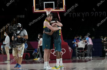 Australia's Joe Ingles (7) and Patty Mills (5) react after beating Slovenia 107-93 during the men's bronze medal basketball game at the 2020 Summer Olympics, in Tokyo, Japan