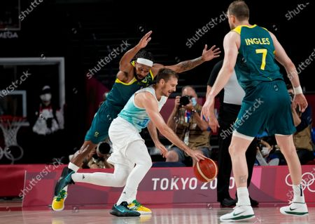 Slovenia's Zoran Dragic (30) drives past Australia's Patty Mills (5) during the men's bronze medal basketball game at the 2020 Summer Olympics, in Tokyo, Japan