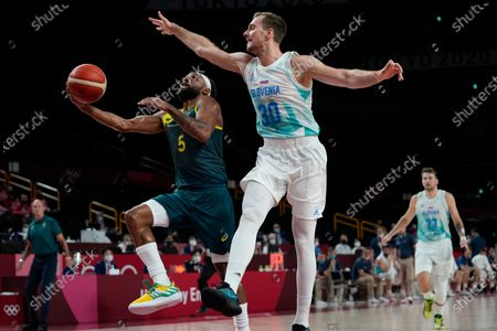 Australia's Patty Mills (5) puts up a shot against Slovenia's Zoran Dragic (30) during the men's bronze medal basketball game at the 2020 Summer Olympics, in Tokyo, Japan