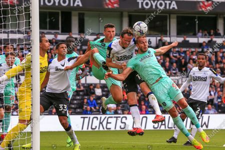 Jordan Holmes (9) of Huddersfield Town  and Richard Stearman (16) of Derby County   compete for the ball during the EFL Sky Bet Championship match between Derby County and Huddersfield Town at the Pride Park, Derby
