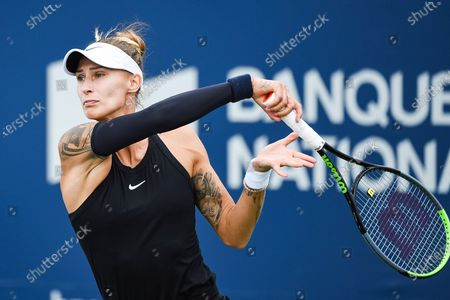 Polona Hercog (SLO) tracks her return during the WTA National Bank Open qualifying round match at IGA Stadium in Montreal, Quebec