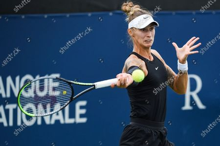Polona Hercog (SLO) gets ready to return the ball during the WTA National Bank Open qualifying round match at IGA Stadium in Montreal, Quebec