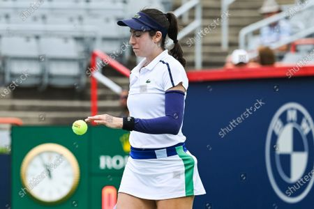 Christina McHale (USA) gets a ball during the WTA National Bank Open qualifying round match at IGA Stadium in Montreal, Quebec