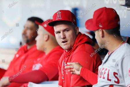 Los Angeles Angels' Mike Trout, center, talks with Jose Iglesias, right, before a baseball game against the Los Angeles Dodgers in LosAngeles