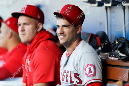Los Angeles Angels' Jose Iglesias, right, with Mike Trout, left, before a baseball game against the Los Angeles Dodgers in LosAngeles