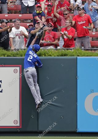 Kansas City Royals center fielder Michael A. Taylor (2) can't quite reach the home run ball hit by St. Louis Cardinals' Dylan Carlson in the first inning of a baseball game, in St. Louis