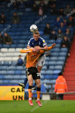 Oldham Athletic's Carl Piergianni tussles with Lewis Collins of Newport County during the Sky Bet League 2 match between Oldham Athletic and Newport County at Boundary Park, Oldham, England on 7th August 2021.