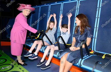The Queen's look-a-like helps Prince George and Princess Charlotte get ready for an awe-inspiring adventure on the UK's first flying theatre ride, Flight of the Sky Lion at the LEGOLAND® Windsor Resort.